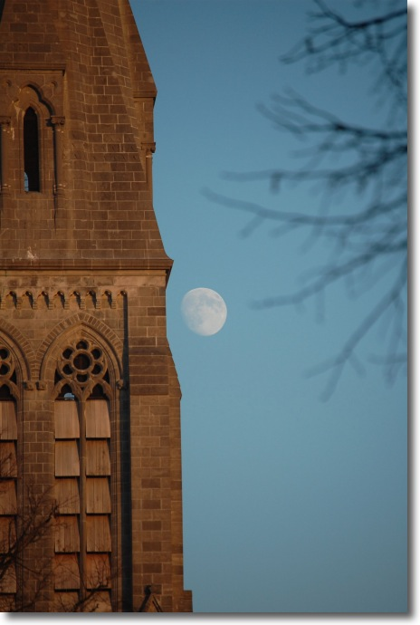 The Moon beside the spire of the Gunne Chapel in Maynooth